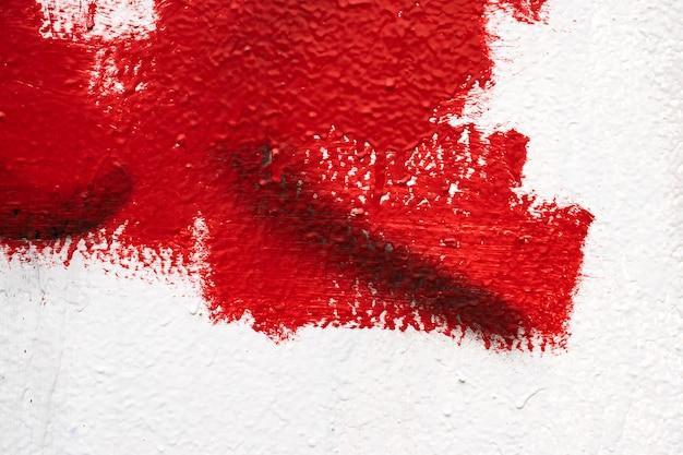 Ściana tekstur, farba kroplowa, kit, czerwono-biała ściana