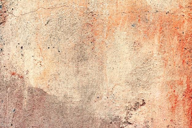 Ściana w tle z kitem pomalowanym na różowo powierzchni tekstury