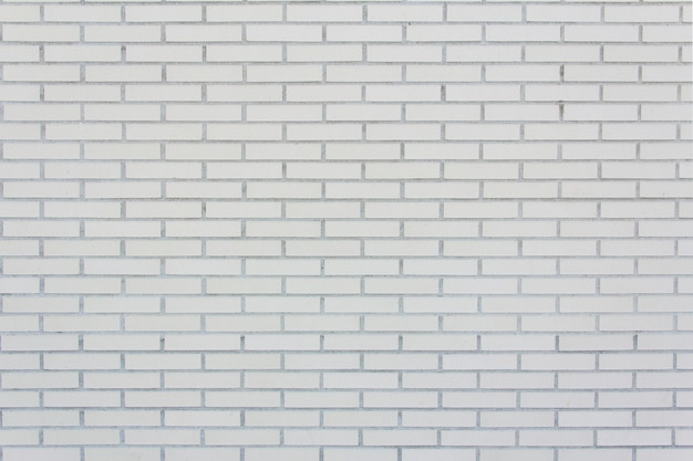 Ściana z białej cegły licowanej średniej wielkości. tekstura. tło.