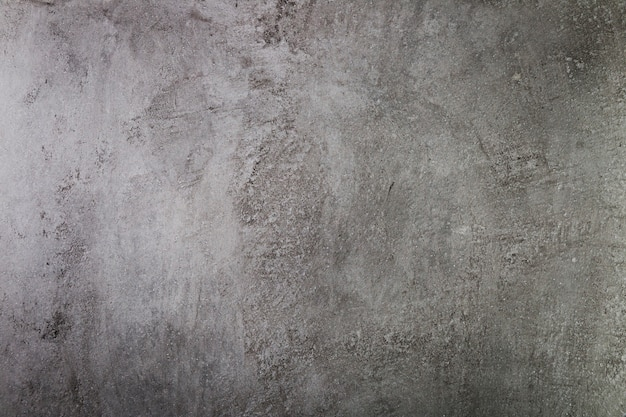 Ściana z ciemnego cementu o szorstkiej powierzchni