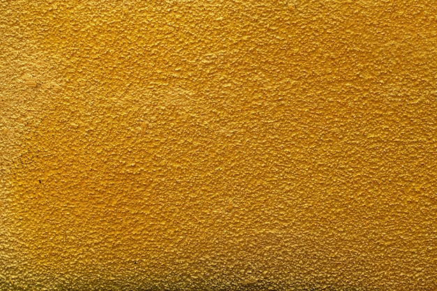 Ściana złoto szorstkie tło lub tekstura
