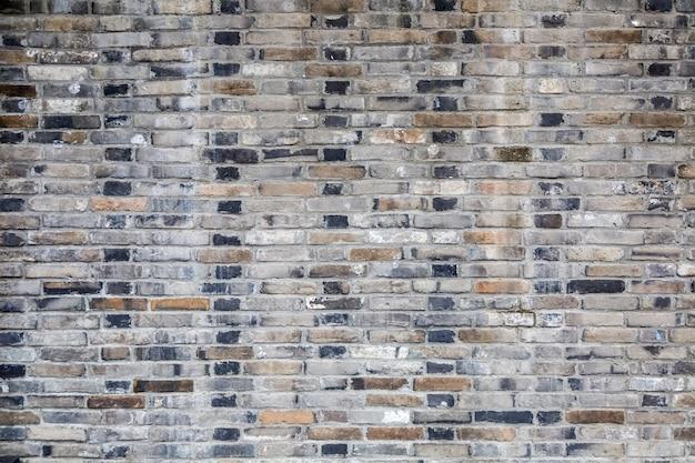 Ściany tekstury ściany z cegły z cegły ogrodzenia zielone