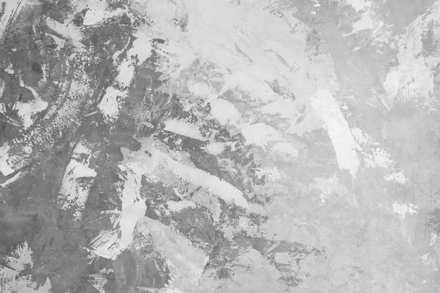 Ściany tynku w stylu loftu, szara, biała, pusta przestrzeń używana jako tapeta. popularny w domu