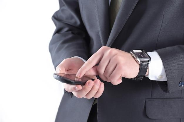 Ścieśniać. biznesmen piszący sms-y na smartfonie.ludzie i technologie
