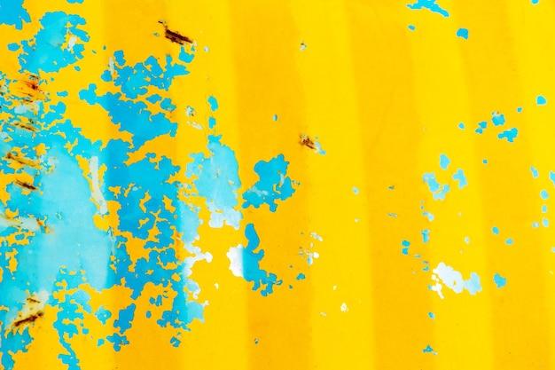 Selektywna ostrość zardzewiała metalowa płyta lub stary metal żółty i niebieski stalowy metalowy rdza tło tekstury