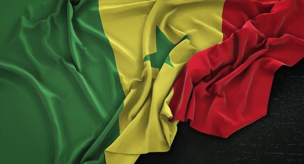 Senegal flag zgnieciony na ciemnym tle renderowania 3d