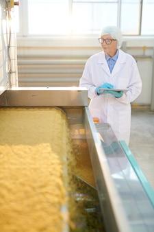 Senior woman in food factory workshop