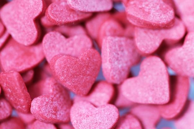 Serca różowe słodycze tło na walentynki