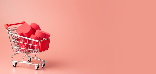 Serca w koszyku i wózku supermarketu na kolorowym tle. tło na walentynki (14 lutego) i miłość.
