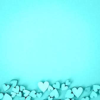 Serce świętego walentego tło u dołu. kolor akwamaryn, aqua.