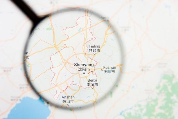 Shenyang, china city wizualizacja ilustracyjna koncepcja na ekranie wyświetlacza przez szkło powiększające