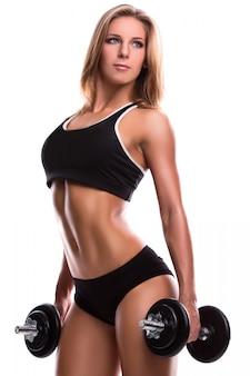 Silna sprawności fizycznej kobieta z dumbbells