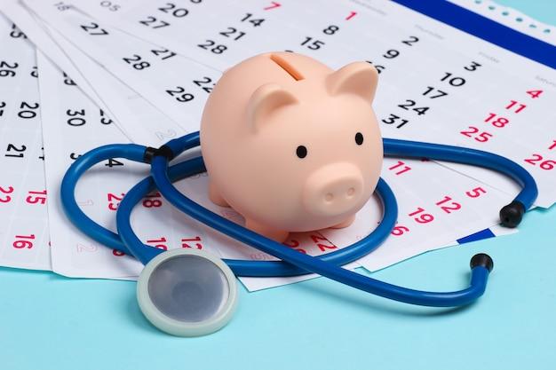 Skarbonka ze stetoskopem z miesięcznym kalendarzem na niebiesko