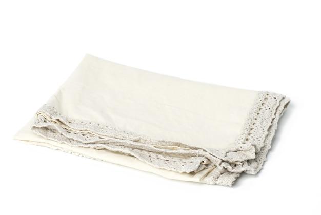 Składany beżowy ręcznik lniany na białym tle, widok z góry