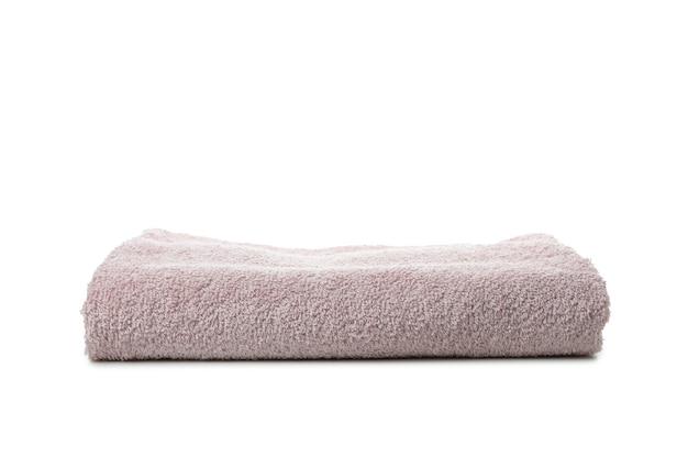 Składany czysty ręcznik na białym tle