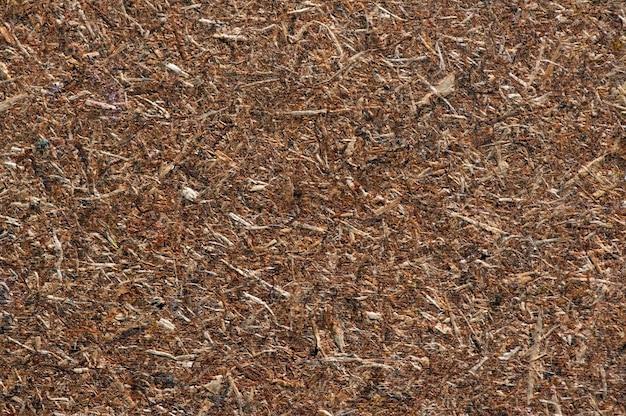 Sklejka, prasowany panel drewniany, tło tekstury płyty wiórowej, w płytkiej ostrości