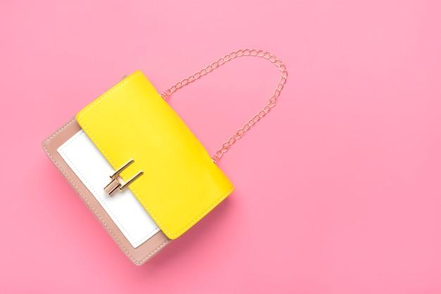 Skórzana torebka w kolorach żółtym, beżowym, białym