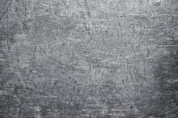 Skręcony arkusz starego metalu tekstury, wyblakła ściana z blachy stalowej