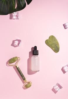 Skrobak jade gua sha, wałek do masażu twarzy i olej kosmetyczny z liściem monstery