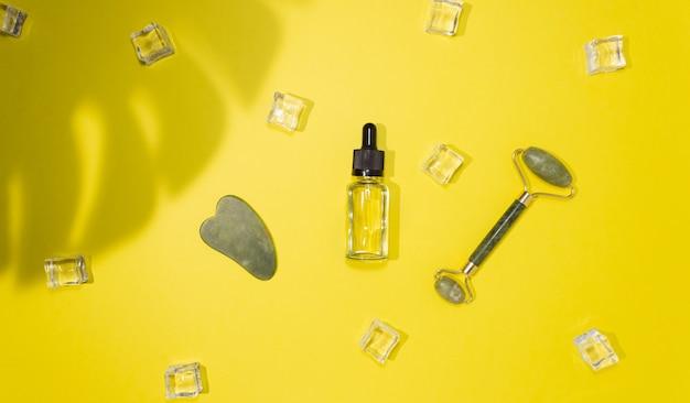 Skrobak jade gua sha, wałek do masażu twarzy i olej kosmetyczny