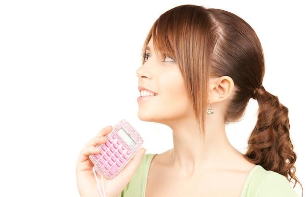 Śliczna nastolatka z kalkulatorem na białym