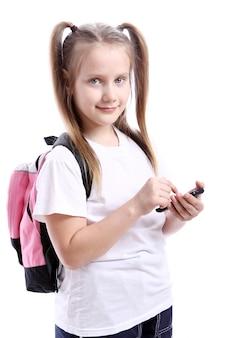 Śliczna uczennica z telefonem komórkowym