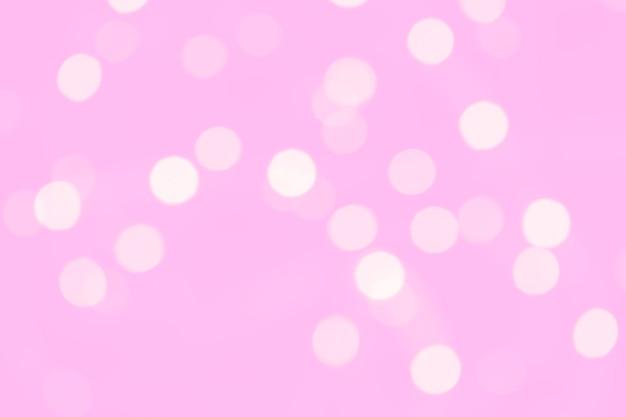 Śliczny dziewczęcy pastelowy różowy tło z zamazanymi bokeh światłami