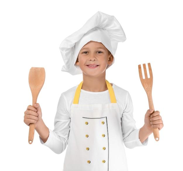 Śliczny mały kucharz na białym