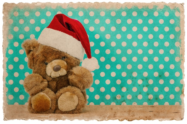 Śliczny miś vintage z santa hat. świąteczna dekoracja. zdjęcie w stylu retro pocztówka