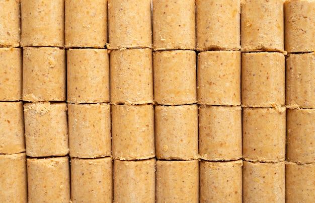 Słodki brazylijski orzeszki ziemne o nazwie pacoca tło. od obchodów czerwca
