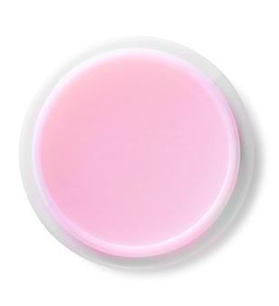 Słoik z różowym kremem do ciała na białym tle widok z góry. ze ścieżką przycinającą