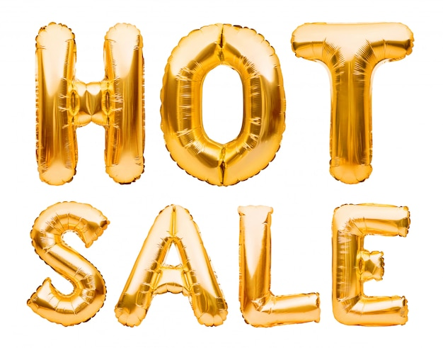 Słowa gorąca sprzedaż wykonana ze złotych nadmuchiwanych balonów na białym tle. balony helowe złota folia tworząca frazę super sprzedaż.