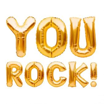 Słowa you rock wykonane ze złotych nadmuchiwanych balonów na białym tle