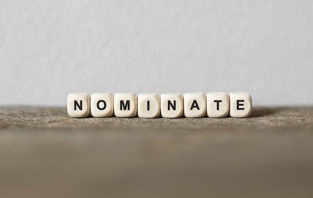 Słowo nominacja wykonane z drewna klocki, obraz