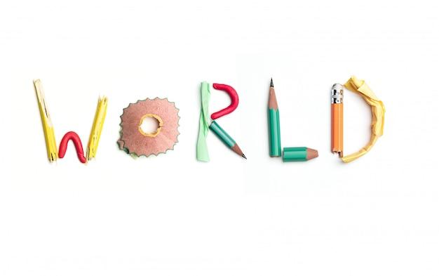 Słowo świat stworzony z materiałów biurowych.
