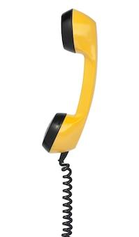 Słuchawka z rocznika żółty telefon. na białym tle