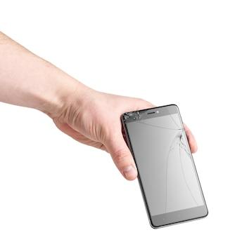 Smartfon z pękniętym ekranem w męskiej dłoni