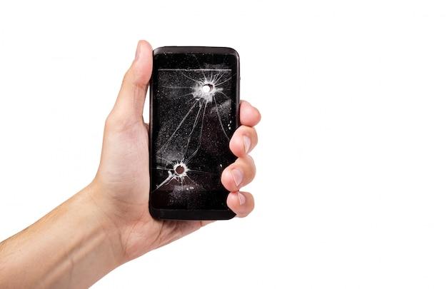 Smartphone z dziura po kuli na bielu