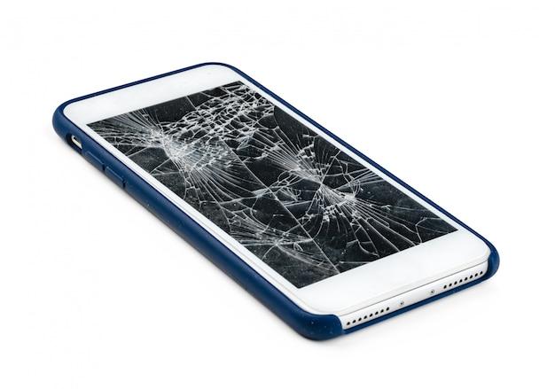 Smartphone z uszkodzonym ekranem odizolowywającym na bielu