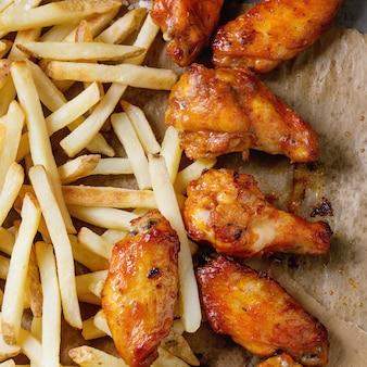 Smażone udka z kurczaka z frytkami