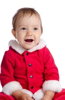 Śmieszne śpiewające dziecko w santa claus ubrania na białym tle