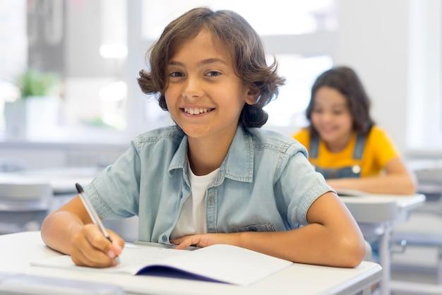 Smiley boy writing