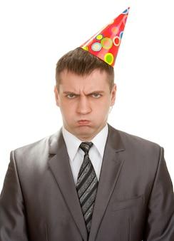 Smutny biznesmen urodziny w kapeluszu