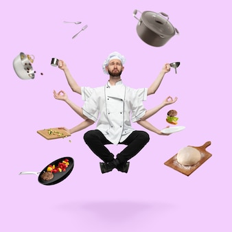 Smutny przystojny kucharz, szef kuchni wieloręki piekarz lewitujący na białym tle na różowym tle studio ze sprzętem. pojęcie zawodu, pracy, gotowania, kuchni. wielozadaniowość jak shiva. kolaż artystyczny.