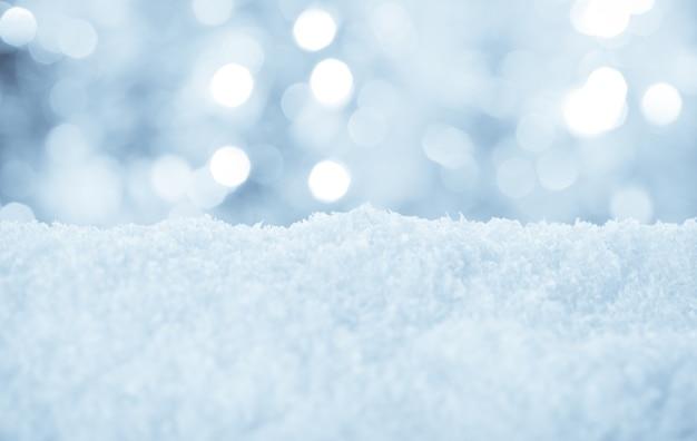 Śnieg i bokeh - świąteczne tło dla projektu