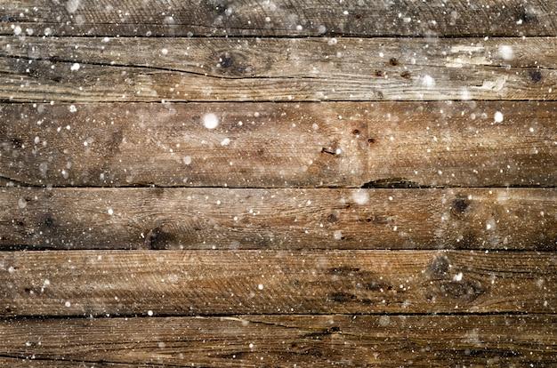 Śnieżny brown drewniany tło. baner z miejsca na kopię
