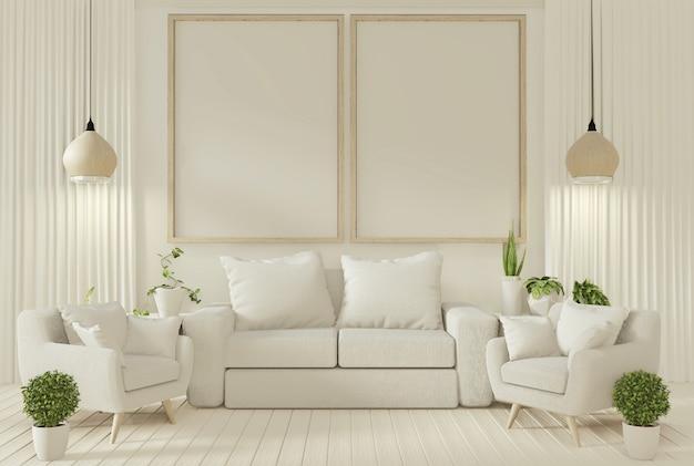 Sofa i rośliny ozdobne w salonie z białą ścianą.