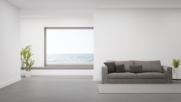 Sofa na betonowej podłodze dużego salonu w nowoczesnym domu lub luksusowym hotelu.