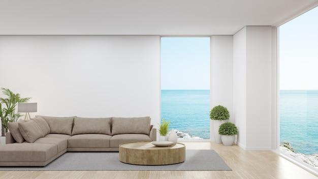 Sofa na drewnianej podłodze dużego salonu w nowoczesnym domu