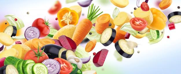 Spada mieszanka różni warzywa odizolowywający na biel ścianie